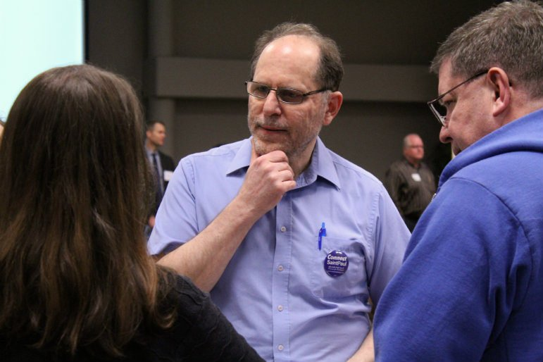 Tom Goldstein (center) speaks with fellow St. Paul residents during a public hearing regarding the Snelling-Midway stadium development on June 7. Photo by Cristeta Boarini.