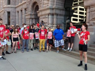 15 Now activists rally at City Hall.