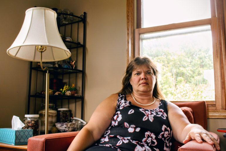 Lara, pictured here in her home. Fifteen years ago, she was caught in a vicious cycle of high-interest payday loan debt. Photo by Cristeta Boarini.