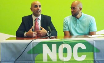 Neel Kashikari, left, discusses racial disparities with NOC Executive Director Anthony Newby, right. Photo courtesy of Insight News.