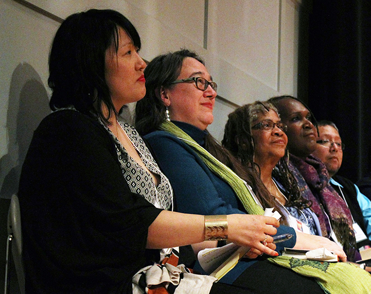 """Sun Yung Shin (left), Heid E. Erdrich (left-center), Carolyn Holbrook (center), Andrea Jenkins (right) and Rodrigo Sanchez-Chavarria (far-right) sit on stage for the launch of """"A Good Time For The Truth"""" at the Minnesota Historical Society. Photo by Cristeta Boarini."""