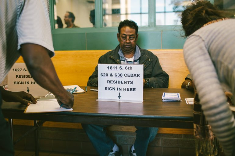 Residents and community members sign in to speak at the Oct. 5 Minneapolis Highrise Representative Council meeting. Photo by Alexa Aretz.