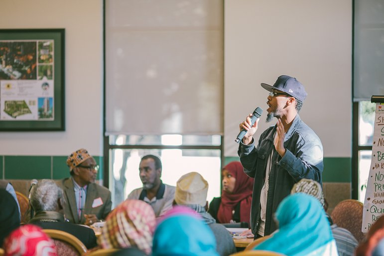 Youth advocate and CVE critic Burhan Mohumed speaks at the Oct. 5 Minneapolis Highrise Representative Council meeting. Photo by Alexa Aretz.