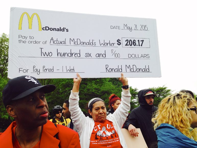 Blanca Gonzalez (center) is a fast-food worker and organizer with CTUL. Here, she is pictured protesting at McDonald's headquarters in Oak Brook, Ill. Photo by Taylor Shevey.