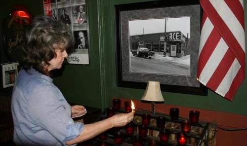 Geri Connelly lighting candles at shring
